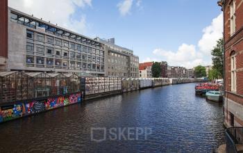 buitenkant kantoor Amsterdam Singel omgeving ramen uitzicht