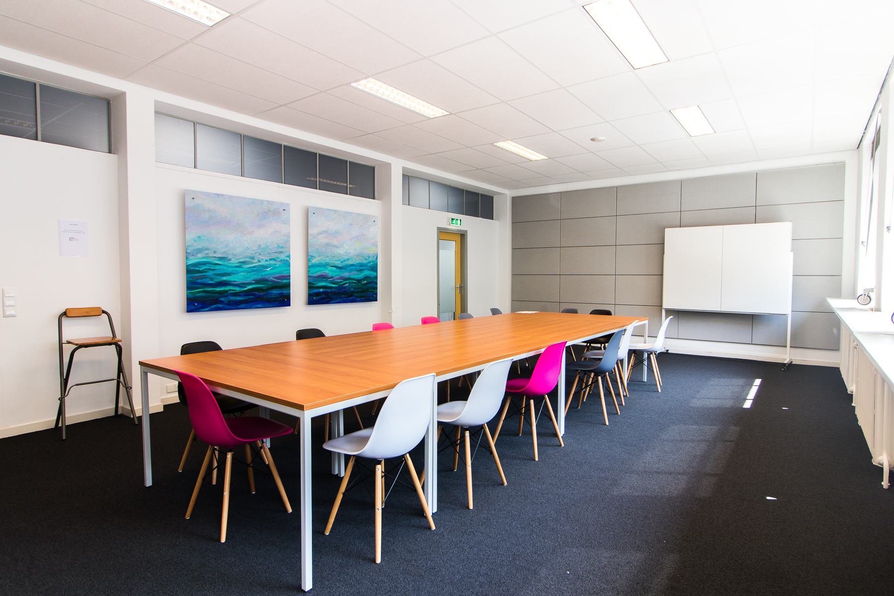 Multiple office spaces present for different group sizes