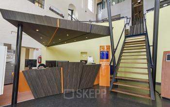 central reception desk at entrance of building