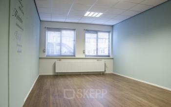 empty office space two windows heating