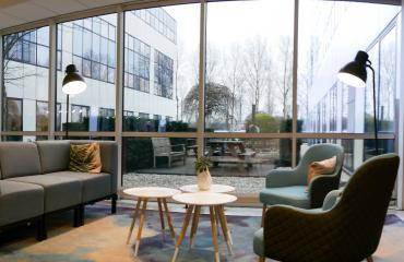 Chairs and couch in office building Capelle