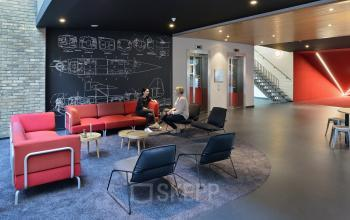 chalkboard meeting place couch chairs