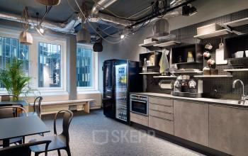 Voll ausgestattete Küche mit Sitzgelegenheiten und toller Aussicht