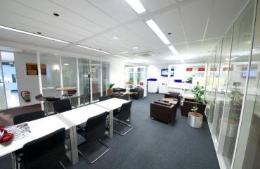 big office space working desks tables and chairs