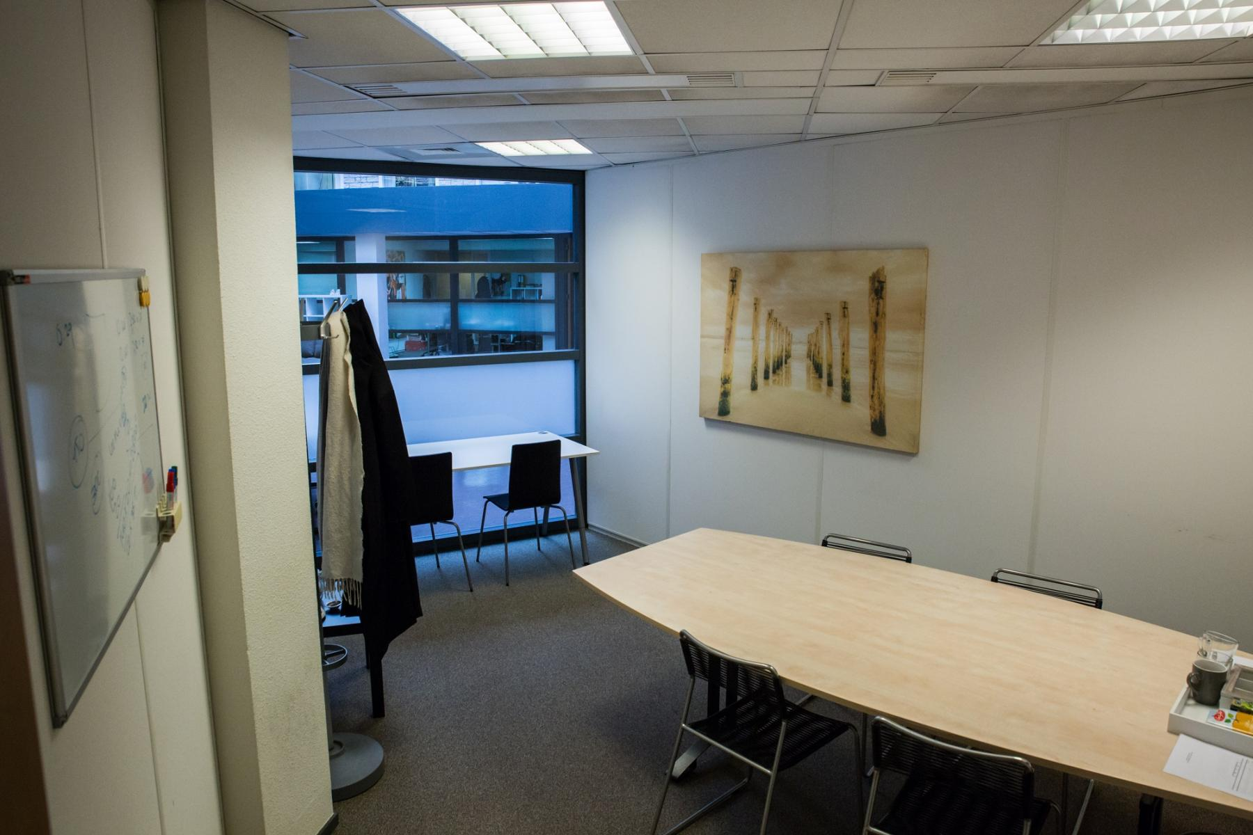 office space chairs tables paintings