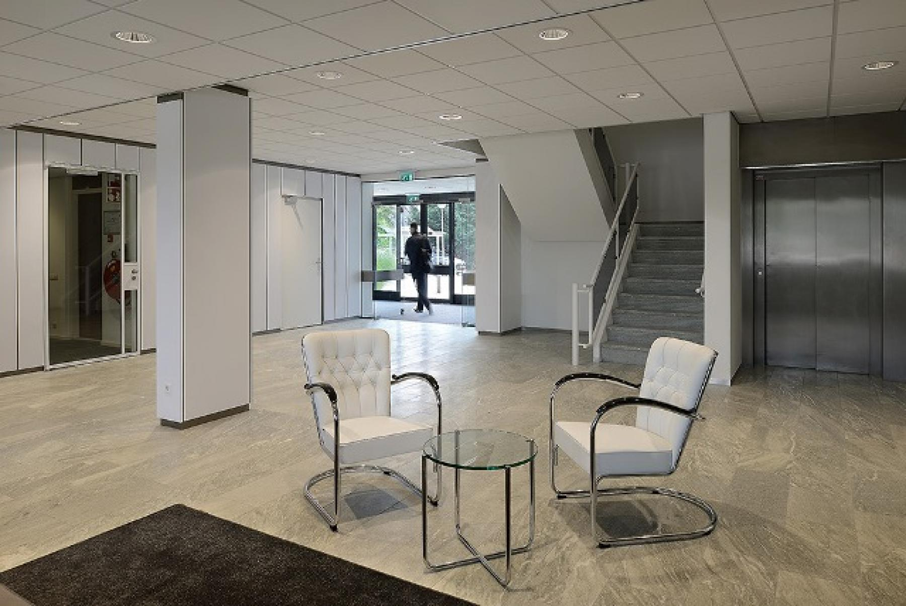 entrance building stairs white chairs table