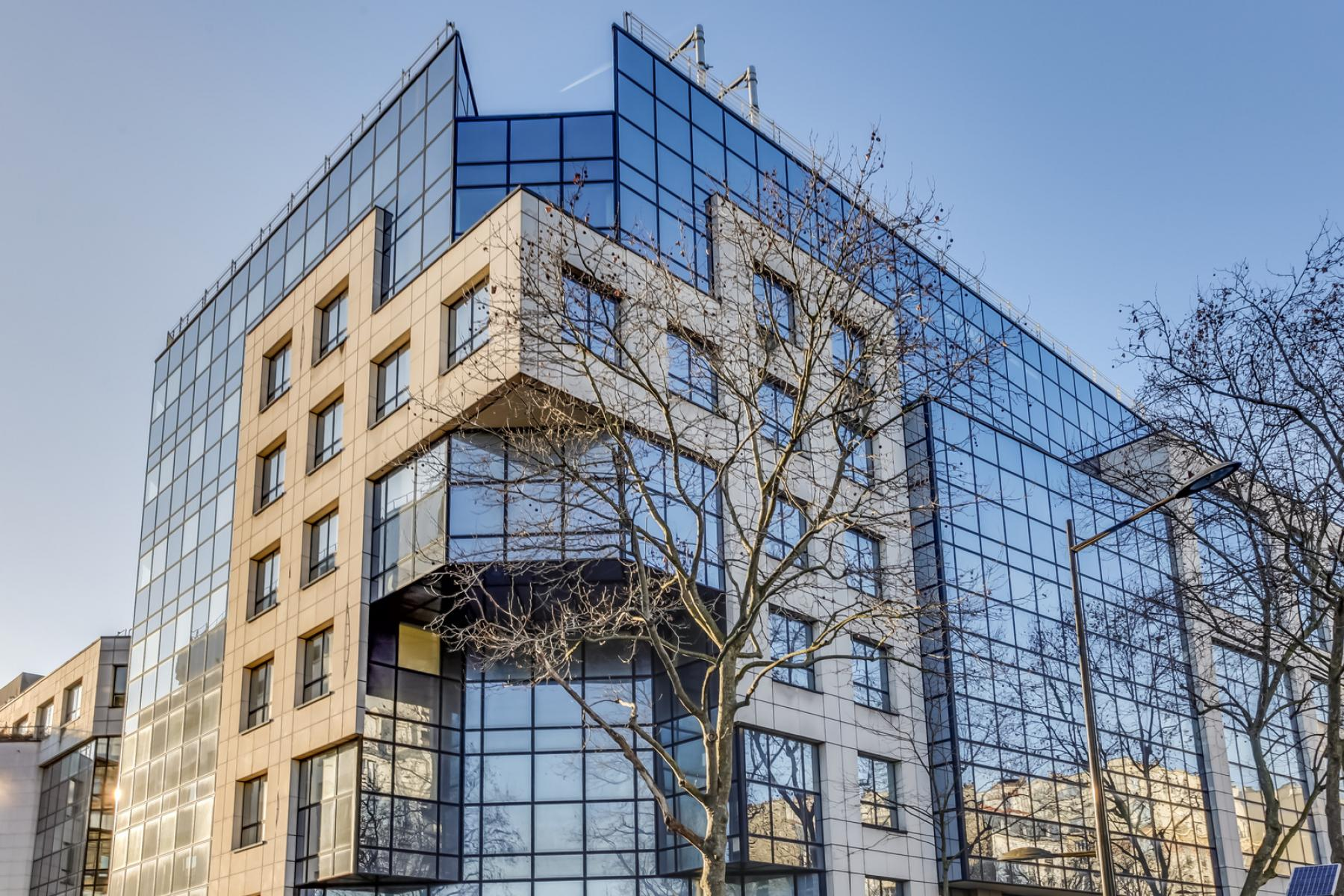 Front of a glazed office building located at Rue Edouard Vaillant