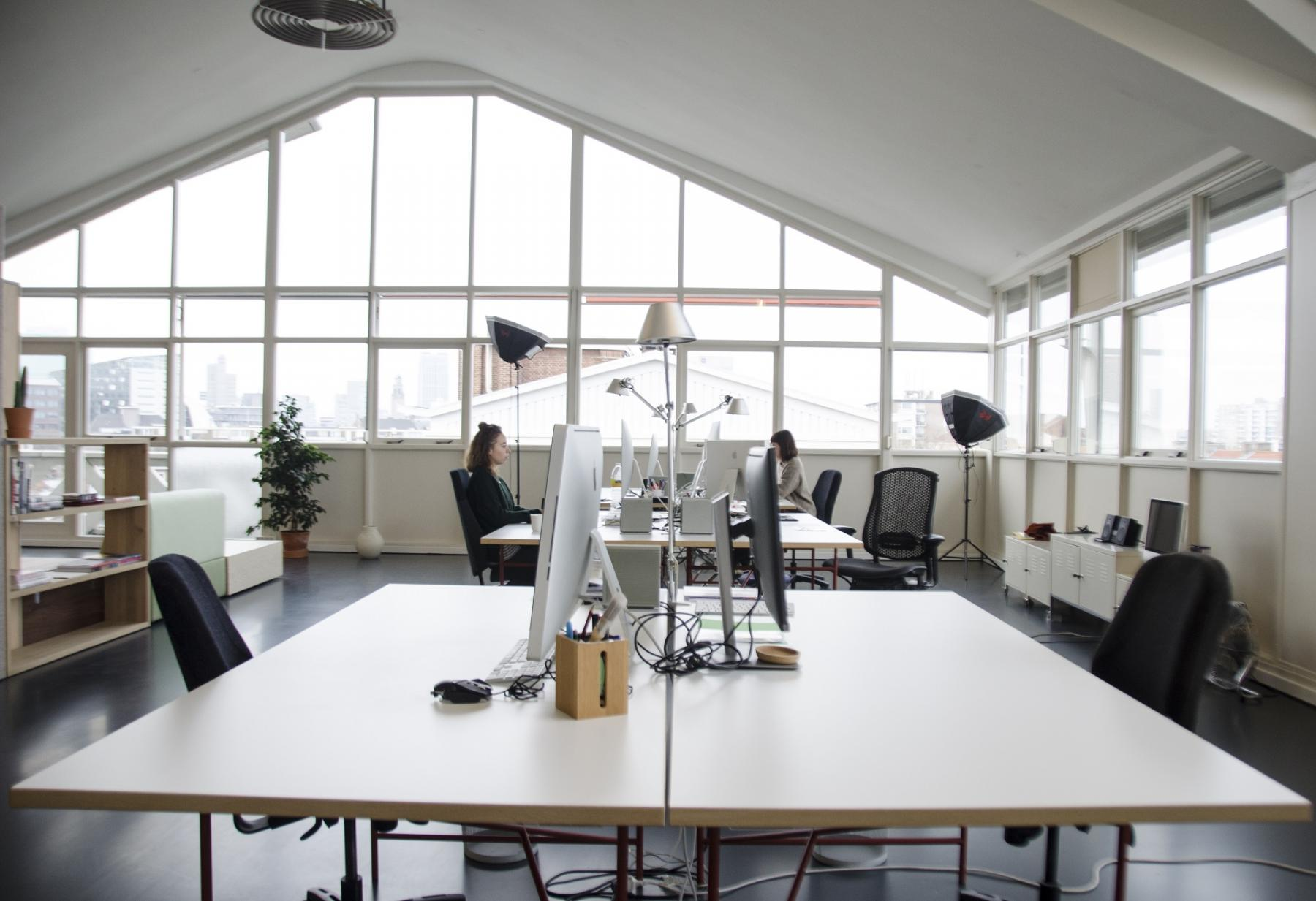 office room working desks windows bright