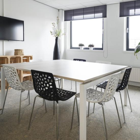 office room for rent in rotterdam white table