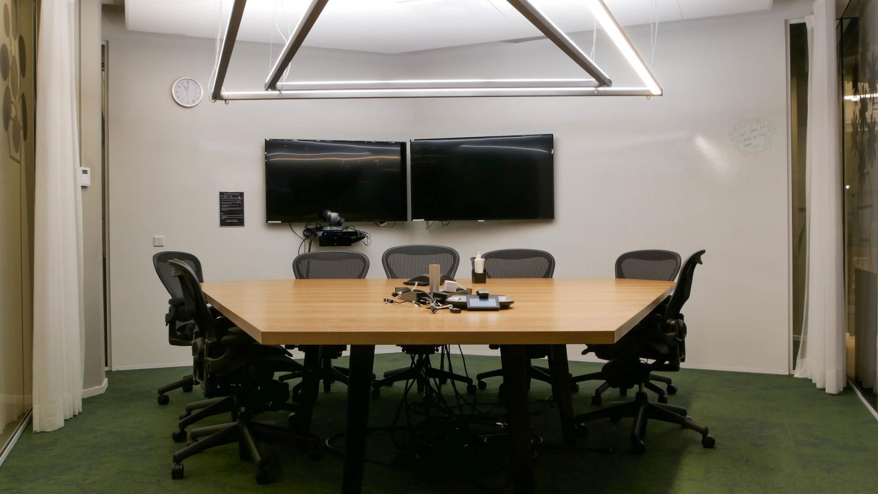 meeting room small table and chairs two screens