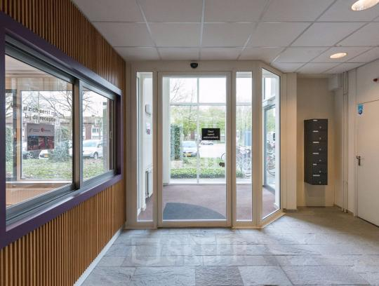 entrance office building tilburg wooden wall