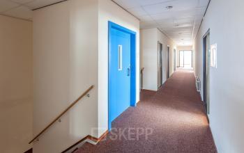 hallway blue door elevator office space zutphen